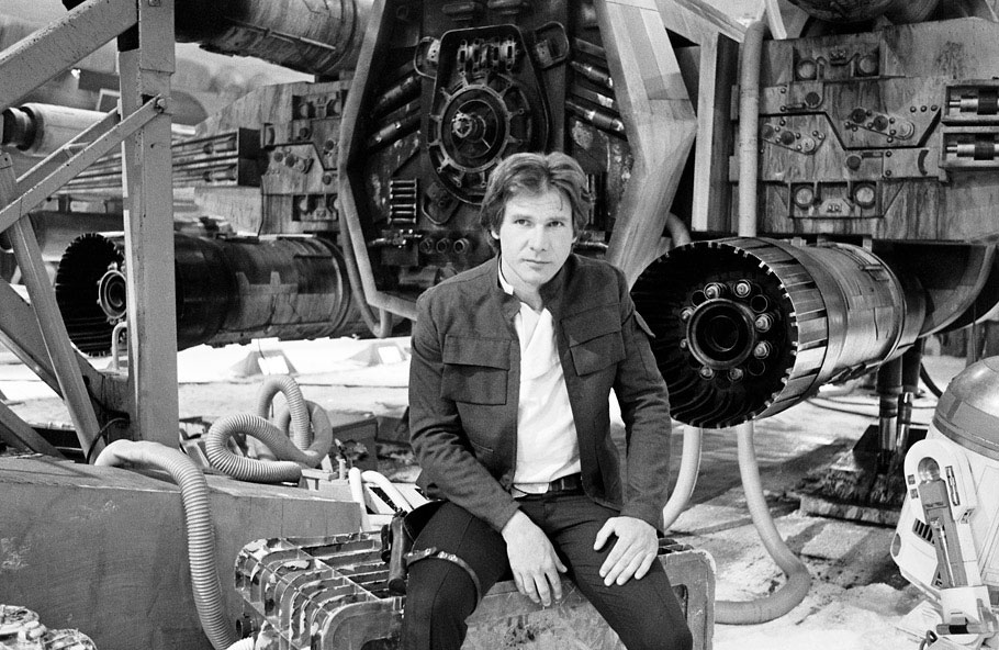 Harrison Ford sitting behind an X-wing